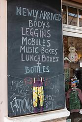 detail of sign outside children's shop in bohemian Prenzlauer Berg, Berlin, Germany