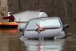 A car is decorated with flowers and an RIP sign as it sits in the flood zone, Monday, May 8, 2017 in Gatineau, Quebec, Canada. Photo by Adrian Wyld /The Canadian Press/ABACAPRESS.COM