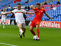 Football - 2020 / 2021 UEFA Nations League - Group B4 - Wales vs Bulgaria<br />      <br /> Ben Davies of Wales tackled by Yanis Karabelyov of Bulgaria<br /> in a match played with no crowd due to Covid 19 coronavirus emergency regulations, in an almost empty ground, at the Cardiff City Stadium.<br /> <br /> COLORSPORT/WINSTON BYNORTH