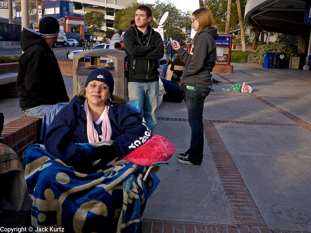 obamatucson 12 JANUARY 2011 - TUCSON, AZ: Maria Flores (CQ) CENTER, SEATED IN LAWN CHAIR, BLUE FLEECE, was the first in the line to see President Obama speak at Wednesday night's service in the McKale Center at the University of Arizona started forming at 18:30 Tuesday night and continued to grow overnight. By 6:30 Wednesday morning at 100 people were in line. The service is for the victims of Saturday's mass shooting at a Safeway in Tucson.    ARIZONA REPUBLIC PHOTO BY JACK KURTZ..Gabrielle Giffords shooting, mass shooting,