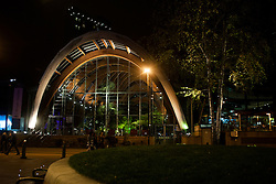 The Arched wooden front of Sheffield Winter Gardens  light up for the evening viewed from the Crucible Theater..8 November 2012.Image © Paul David Drabble