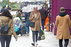 ©Licensed to London News Pictures 13/10/2020  <br /> Bromley, UK. A Shopper with her umbrella up. Autumnal wet weather this afternoon for shoppers in Bromley High Street, Bromley, South East London. Photo credit:Grant Falvey/LNP
