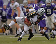 Kansas State linebacker Reggie Walker (53) wraps up Missouri running back Marcus Woods for a loss in the first quarter at Bill Snyder Family Stadium in Manhattan, Kansas, November 19, 2005.  K-State defeated the Missouri Tigers 36-28.