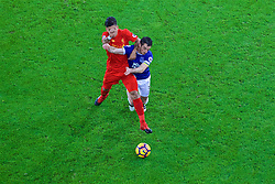 LIVERPOOL, ENGLAND - Monday, December 19, 2016: Liverpool's Roberto Firmino in action against Everton's Leighton Baines during the FA Premier League match, the 227th Merseyside Derby, at Goodison Park. (Pic by Gavin Trafford/Propaganda)