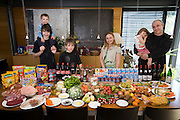 Nico and Loba Engel family at home in Luxembourg with one week's food. Nico is an architect. He designed their home. Model Released. The image is part of a collection of images and documentation for Hungry Planet 2, a continuation of work done after publication of the book project Hungry Planet: What the World Eats.