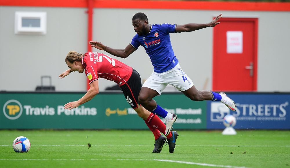 Lincoln City's Harry Anderson vies for possession with Charlton Athletic's Adedeji Oshilaja<br /> <br /> Photographer Chris Vaughan/CameraSport<br /> <br /> The EFL Sky Bet League One - Lincoln City v Charlton Athletic - Sunday 27th September, 2020 - LNER Stadium - Lincoln<br /> <br /> World Copyright © 2020 CameraSport. All rights reserved. 43 Linden Ave. Countesthorpe. Leicester. England. LE8 5PG - Tel: +44 (0) 116 277 4147 - admin@camerasport.com - www.camerasport.com