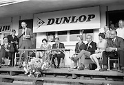 20/08/1967<br /> 08/20/1967<br /> 20 August 1967<br /> Irish Dunlop £1,000 Tournament at Tramore Golf Club, Co. Waterford. Mr. John R. Sheridan (on left), Marketing Director, Irish Dunlop Co., speaking at the rize giving after the competition with (l-r): Mr. J. Kelly, Captain, I.P.G.A.; Mr. Barry Brian, Honorary Secretary, I.P.G.A.; Mr. Sheridan; Mrs John R. Sheridan; Dr. R.F. O'Driscoll, Captain of Tramore Golf Club; Mrs R.F. O'Driscoll; Mr. W.G. Robertson, President, I.P.G.A.; Miss Ann Diver, Lady Captain, Tramore Golf Club and Mr Cyril Kemp, Sports Sales Manager, Irish Dunlop Company.