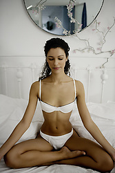 May 30, 2007 - Woman doing yoga on bed.. Model Released (MR) (Credit Image: © Cultura/ZUMAPRESS.com)