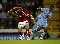 Photo: Rich Eaton.<br /> <br /> Bristol City v Manchester City. Carling Cup. 29/08/2007. Bristol City's Michael McIndoe shields the ball from Shalem Logan of Man City.