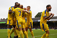AFC Wimbledon midfielder Anthony Wordsworth (40), AFC Wimbledon midfielder Scott Wagstaff (7), AFC Wimbledon midfielder Max Sanders (23) celebrate goal during the EFL Sky Bet League 1 match between Southend United and AFC Wimbledon at Roots Hall, Southend, England on 12 October 2019.