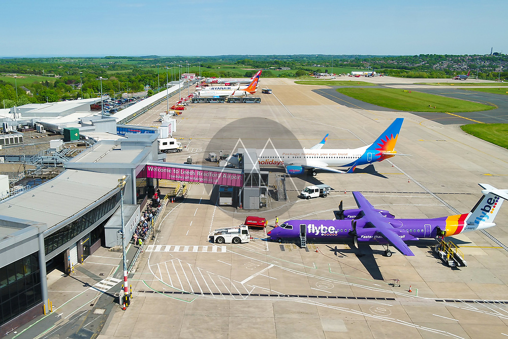 LEEDS, UK - 15 MAY 2018: Aerial view of Leeds Brdford airport from airside. Showing airplanes at the gates and people ready to board.