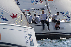 Jesper radich's crew look to windward at Adam Minoprio during the quarter finals of Match Race Germany 2010. World Match Racing Tour. Langenargen, Germany. 23 May 2010. Photo: Gareth Cooke/Subzero Images/WMRT