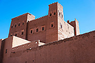 Kasbah in the Draa Valley against blue sky, Morocco.