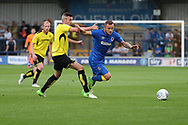 AFC Wimbledon midfielder Dean Parrett (18) battles for possession during the Pre-Season Friendly match between AFC Wimbledon and Burton Albion at the Cherry Red Records Stadium, Kingston, England on 21 July 2017. Photo by Matthew Redman.