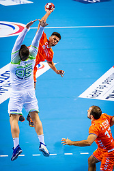 The Dutch handball player Ephrahim Jerry in action against Matic Suholeznik from Slovenia during the European Championship qualifying match on January 6, 2020 in Topsportcentrum Almere