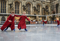 © licensed to London News Pictures. 18/12/2014<br /> Choristers from Winchester Cathedral enjoy ice skating on the artificial rink set up beside the cathedral.<br /> Photo credit : Ian Whittaker/LNP