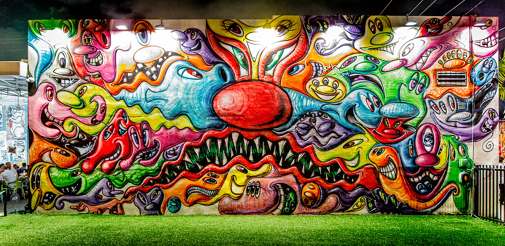 A truly fantastic mural by pop-artist Kenny Scharf at Miami's famous, outdoor, Wynwood Walls street art museum. <br /> <br /> I made this photo in 2015, but in 2011 I had  photographed an earlier version of this mural that had fewer creatures and more white spaces. You can see that version in the previous photo in this online gallery.