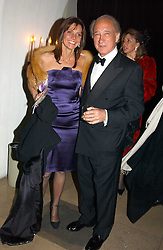COUNTESS DEBONAIRE VON BISMARCK and SIR MARK WEINBERG at a private dinner to unveil the Van Cleef & Arpels jewellery collection 'Couture' with fashion by Anouska Hempel Couture held at The Banqueting House, Whitehall Palace, London on 8th March 2005.<br />