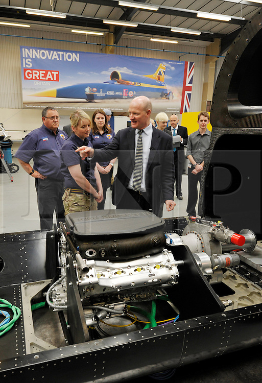 © Licensed to London News Pictures. 04/07/2013. Bristol, UK.  David Willetts, Minister for Science and Universities, takes part in joining parts of the Bloodhound Supersonic Car bodywork together, at official opening of the Bloodhound new technical centre in Avonmouth, Bristol.  The car is being built to go at 1000mph to break the land speed record, powered by a rocket and a Rolls Royce EJ200 jet engine with a Cosworth engine being used as a pump.  The record attempt will take place in South Africa and Bloodhound will be piloted by Wing Commander Andy Green from the RAF.  04 July 2013.<br /> Photo credit : Simon Chapman/LNP