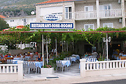 Restaurant and hotel Villa Vrogorac with outside seating terrasse under pergola on the coast of Peljesac peninsula near Orebic Peljesac peninsula. Dalmatian Coast, Croatia, Europe.