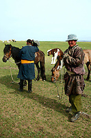 Though Mongolian horsemen and nomads are a rough and tumble lot, this one displays childlike qualities with an infant in his flock of sheep. Nomadic people move from one place to another, rather than settling permanently in one location. Nomads in Mongolia are usually of the pastoral type following seasonally available wild plants and game, moving with them in ways that avoid depleting pastures beyond their ability to recover.