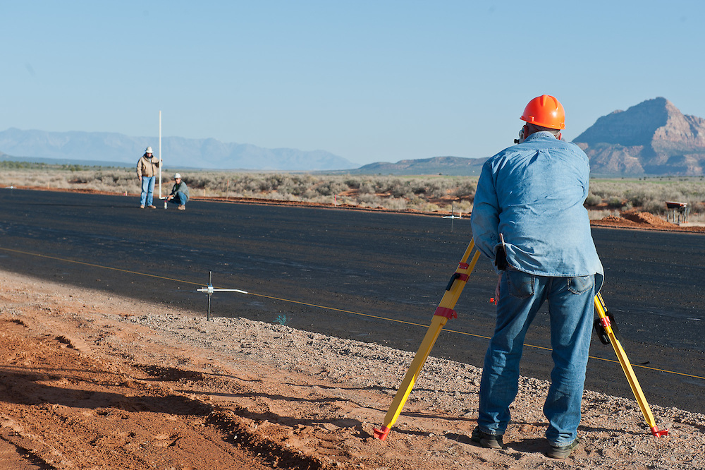 image of construction worker working on the runway at Colorado City Municipal Airport.