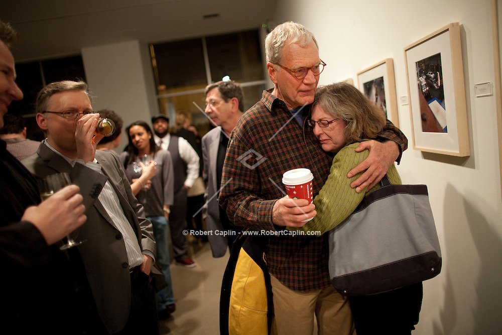 """David Letterman embraces his producer, Barbara Gaines, at his staff's holiday party and photo gallery exhibition by his staff writer Steve Young entitled """"CELEBRIGUM"""" held at Ameringer McEnery Yohe Gallery  in New York. ..Photo by Robert Caplin."""