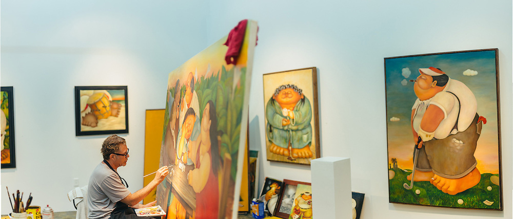 Portrait of Artist Alberto Godoy painting in his studio at Silver Street Studios. <br /> Photographed by editorial photographer Nathan Lindstrom.