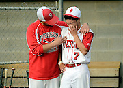 Pierson/Bridgehampton head coach Jon Tortorella consoles teammate Johnny Chisholm after Pierson was defeated by Hoosic Valley, 7-2, during the New York State Public High School Class C baseball state final championship game in Binghamton, NY, Saturday, June 14, 2014. (Photo by Heather Ainsworth)