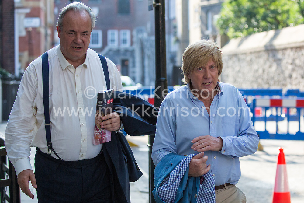 London, UK. 23 July, 2019. James Gray (l), Conservative MP for North Wiltshire, and Michael Fabricant (r), Conservative MP for Lichfield, leave after attending a celebration in Westminster of Boris Johnson's election as Conservative Party leader and replacement of Theresa May as Prime Minister organised by the pro-Brexit European Research Group (ERG).
