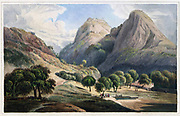 Jag Deo, and Warrangur, Hill Forts in the Barramah'l, 1801  The artists recorded, 'Jag Deo, and Warrangur, are two of the twelve Hill Forts, or Barramah'l, which were in the possession of the late Sultaun Tippoo; these are of the lesser class, but, like most of the hill forts, are strongly fortified quite to their rocky summits.' The hill fort rises above the village of Jagadevapalaiyam in two peaks, one Jagadevadrug, and the other, separated by a saddle, Kevalgadai (Cowel Gur). The Daniells are mistaken in calling the second peak Warrungur. Jagadeva has some of the finest defensive fortifications of all the hill forts in the Baramahal, with ramparts more than 30 feet high rising above a steep rock glacis, while the remains of the old town around its foot testify to its once being much more important. From the book ' Oriental scenery: one hundred and fifty views of the architecture, antiquities and landscape scenery of Hindoostan ' by Thomas Daniell, and William Daniell, Published in London by the Authors May 1, 1813