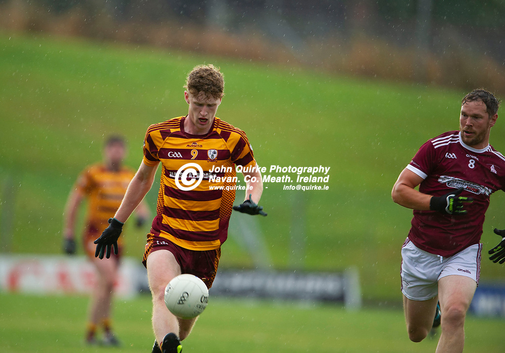 27-07-21. Carnaross v St. Vincent's Tailteann Cup Final 2020.<br /> Cian McGlynn, Carnaross solos forward with Robert Tallon St. Vincents chasing in the Meath Tailteann Cup Final 2020.<br /> Photo: John Quirke / www.quirke.ie<br /> ©John Quirke Photography, 16 Proudstown Road, Navan. Co. Meath. (info@quirke.ie / 046-9028461 / 087-2579454).