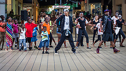 """Lavon Patterson (left) and Victor Lewis, Jr. of """"Invincible"""" lead a dance workshop at Tutu Park Mall.  Dancers from Invicible, a Michael Jackson tribute, will perform at Reichhold Center for the Arts Saturday at 7pm.  Tutu Park Mall.  1 November 2013.  © Aisha-Zakiya Boyd"""
