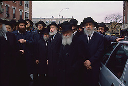 Menachem Mendel Schneerson, Rabbi,  leader of the Labavich orthodox community in Crown Heights, Brooklyn, attends a funeral for a murdered woman from the community, 07/02/1992