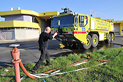 Israel, Ben-Gurion international Airport. Emergence response team station. Fireman prepares and readies truck