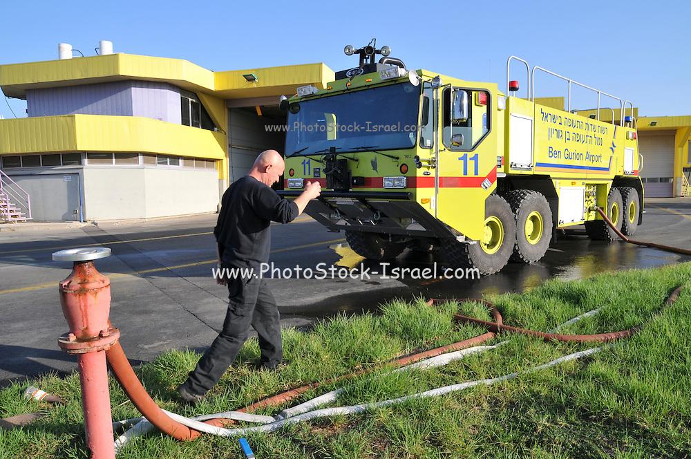Israel, Ben-Gurion international Airport. Emergence response team station. Fireman prepares and readies truck