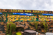 Wooden mural depicting the legend of Ulun Danu Beratan Temple, Bali, Indonesia