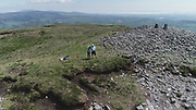 Slieve Gullion is a mountain in the south of County Armagh, Ireland, The mountain is the heart of the Ring of Gullion and is the highest point in the county, with an elevation of <br /> Elevation: 573 m<br /> Ulster, Mourne Mountains