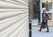 23rd February, Cheltenham, England. A woman walks through the Chelteham Town centre during the third national lockdown.