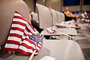 "July 2 - PHOENIX, AZ: American flags on chairs in the gym at the South Mountain Community College before the naturalization ceremony. Nearly 200 people were sworn in as US citizens during the ""Fiesta of Independence"" at South Mountain Community College in Phoenix, AZ, Friday. The ceremony is an annual event on th 4th of July weekend and usually the largest naturalization ceremony of the year in the Phoenix area.  Photo by Jack Kurtz"