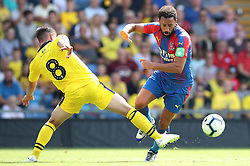Oxford United's Cameron Brannagan (left) and Crystal Palace's Andros Townsend battle for the ball during a pre season friendly match at The Kassam Stadium, Oxford.