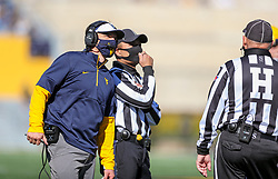 Oct 31, 2020; Morgantown, West Virginia, USA; West Virginia Mountaineers head coach Neal Brown talks with an official during the second quarter against the Kansas State Wildcats at Mountaineer Field at Milan Puskar Stadium. Mandatory Credit: Ben Queen-USA TODAY Sports