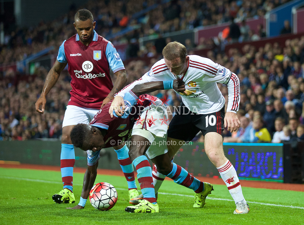 BIRMINGHAM, ENGLAND - Friday, August 14, 2015: Manchester United's captain Wayne Rooney in action against Aston Villa's Idrissa Gueye during the Premier League match at Villa Park. (Pic by David Rawcliffe/Propaganda)