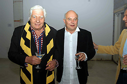 Left to right, GUNTHER SACHS and his son designer ROLF SACHS at an exhibition of work by Rolf Sachs - a unique world-renowned contemporary furniture designer, held in association with the Louisa Guinness Gallery and held at 250 Brompron Road, London on 6th October 2004.<br />