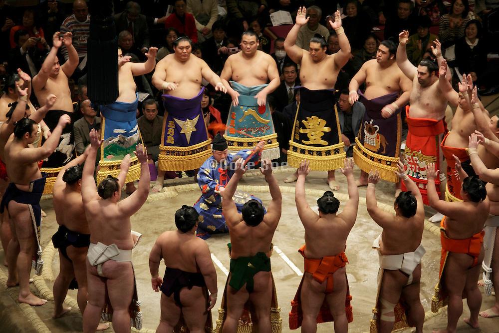 Sumo wrestling event Ryogoky stadium Tokyo performing the ring entering ceremony