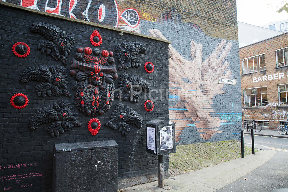Fashionable street art along Redchurch Street on 14th October 2015 in London, United Kingdom. Nestled between Brick Lane and Shoreditch High Street, Redchurch street is a trendy backstreet in the heart of East London