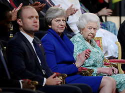 Queen Elizabeth II is joined by Prime Minister Theresa May and Prime Minister of Malta Joseph Muscat during the formal opening of the Commonwealth Heads of Government Meeting in the ballroom at Buckingham Palace in London.