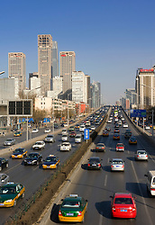 View across highway to highrise buildings in new Central Business District CBD in Chaoyang Beijing 2009