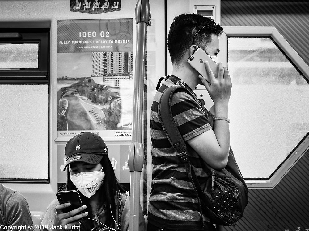 19 JANUARY 2019 - BANGKOK, THAILAND: People wearing breathing masks on the BTS Skytrain in Bangkok. Bangkok has been shrouded in a cloud of polluted air for most of January.    PHOTO BY JACK KURTZ