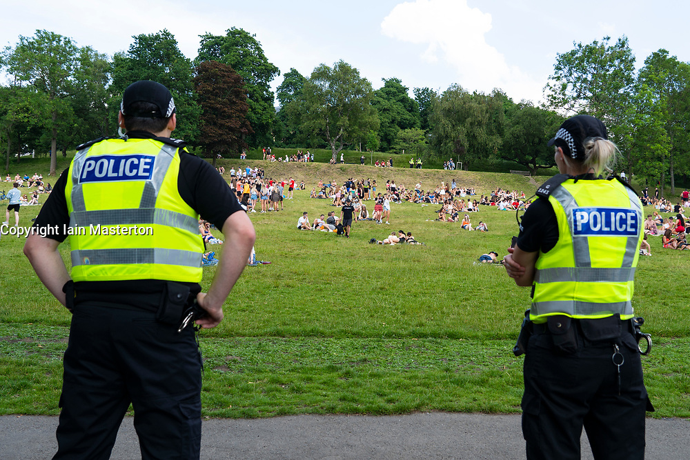 Glasgow, Scotland, UK. 25 June, 2020. Crowds of young people descended on Kelvigrove Park in the city's west end to enjoy the sunshine and hot temperatures of up to 28C.  Police patrols were low key. Iain Masterton/Alamy Live News